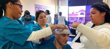 Nurse Assistant students receiving practical training.
