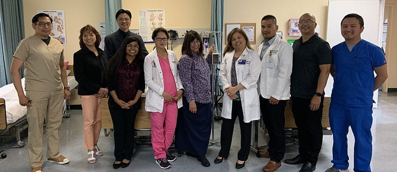 Group of Healthcare Career College instructors standing together in a lab setting.