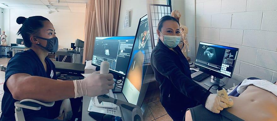 Ultrasound Technician students practicing using ScanTrainer equipment.