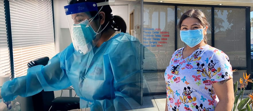 A photo of Ingrid practicing phlebotomy and a photo of her standing outside in scrubs.